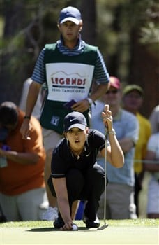 RENO, NV - AUGUST 1: Michelle Wie lines up a putt in front of her caddy, Tim Vickers, during the second round of the Legends Reno-Tahoe Open at the Montreux Golf and Country Club on August 1, 2008 in Reno, Nevada. (Photo by Max Morse/Getty Images)
