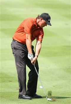 AKRON, OH - AUGUST 03:  Phil Mickelson of USA plays his approach shot on the fourth hole during final round of the World Golf Championship Bridgestone Invitational on August 3, 2008 at Firestone Country Club in Akron, Ohio.  (Photo by Stuart Franklin/Getty Images)