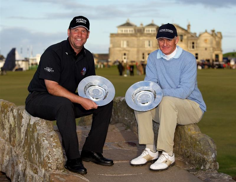ST. ANDREWS, UNITED KINGDOM - OCTOBER 05: John Bickerton of England and Bruce Watson celebrate on the Swilken Bridge with their trophies after winning the team event in The Alfred Dunhill Links Championship at The Old Course on October 5, 2008 in St.Andrews, Scotland. (Photo by Ross Kinnaird/Getty Images)