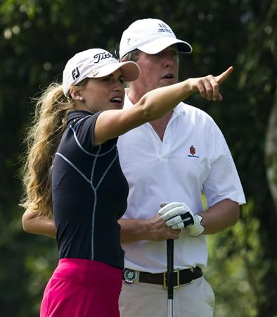 HAIKOU, CHINA - OCTOBER 30:  Spanish golfer Belen Mozo (L) gives instructions to Hugh Grant of Great Britain on the 10th tee during day four of the Mission Hills Start Trophy tournament at Mission Hills Resort on October 30, 2010 in Haikou, China. The Mission Hills Star Trophy is Asia's leading leisure liflestyle event and features Hollywood celebrities and international golf stars.  (Photo by Victor Fraile/Getty Images for Mission Hills)