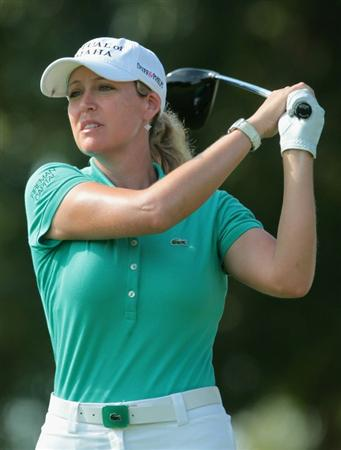 SINGAPORE - FEBRUARY 25:  Cristie Kerr of the USA watches her tee shot on the 15th hole during the second round of the HSBC Women's Champions 2011 at the Tanah Merah Country Club on February 25, 2011 in Singapore, Singapore.  (Photo by Scott Halleran/Getty Images)
