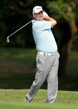 HONG KONG - NOVEMBER 19: Kenneth Ferrie of England plays a shot on the 14th hole during day two of the UBS Hong Kong Open at The Hong Kong Golf Club on November 19, 2010 in Hong Kong, Hong Kong. ( Photo by Stanley Chou/Getty Images )
