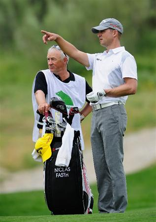 MADRID, SPAIN - MAY 27:  Niclas Fasth of Sweden and caddie during the first round of the Madrid Masters at Real Sociedad Hipica Espanola Club De Campo on May 27, 2010 in Madrid, Spain.  (Photo by Stuart Franklin/Getty Images)