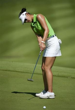 ROGERS, AR - SEPTEMBER 11:  Michelle Wie makes an eagle putt on the 18th hole during the second round of the P&G NW Arkansas Championship at the Pinnacle Country Club on September 11, 2010 in Rogers, Arkansas.  (Photo by Robert Laberge/Getty Images)