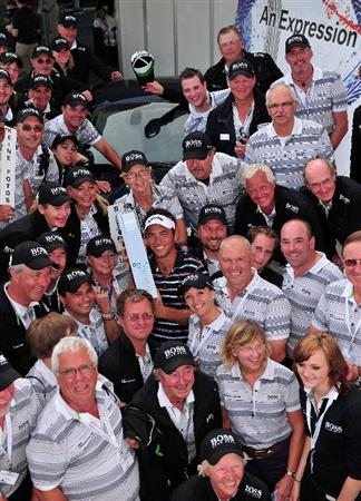 MUNICH, GERMANY - JUNE 28:  Nick Dougherty of England holds the trophy with the volunteers after winning The BMW International Open Golf at The Munich North Eichenried Golf Club on June 28, 2009, in Munich, Germany.  (Photo by Stuart Franklin/Getty Images)
