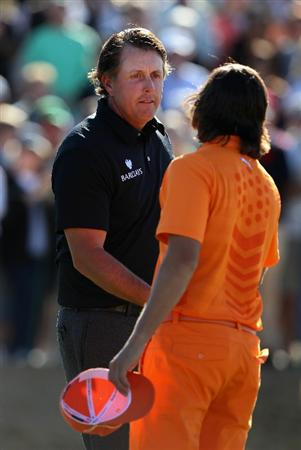 SCOTTSDALE, AZ - FEBRUARY 07:  Phil Mickelson shakes hands with Rickie Fowler following their final round of the Waste Management Phoenix Open at TPC Scottsdale on February 7, 2011 in Scottsdale, Arizona.  (Photo by Christian Petersen/Getty Images)