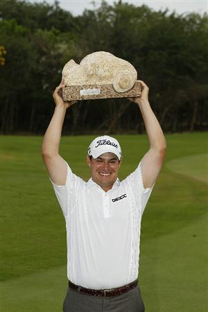 PLAYA DEL CARMEN, MEXICO - FEBRUARY 27:  Johnson Wagner holds the trophy overhead after winning the Mayakoba Golf Classic at Riviera Maya-Cancun held at El Camaleon Golf Club on February 27, 2011 in Playa del Carmen, Mexico.  (Photo by Michael Cohen/Getty Images)