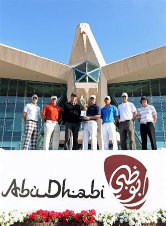 ABU DHABI, UNITED ARAB EMIRATES - JANUARY 19:  (From left to right) Ian Poulter of England, Lee Westwood of England, Geoff Ogilvy of Australia, defending champion Paul Casey of England, Anthony Kim of the USA, Martin Kaymer of Germany and Rory McIlroy of Northern Ireland pose for a photograph in front of the clubhouse during a photocall at The Abu Dhabi Golf Championship at Abu Dhabi Golf Club on January 19, 2010 in Abu Dhabi, United Arab Emirates.  (Photo by Andrew Redington/Getty Images)