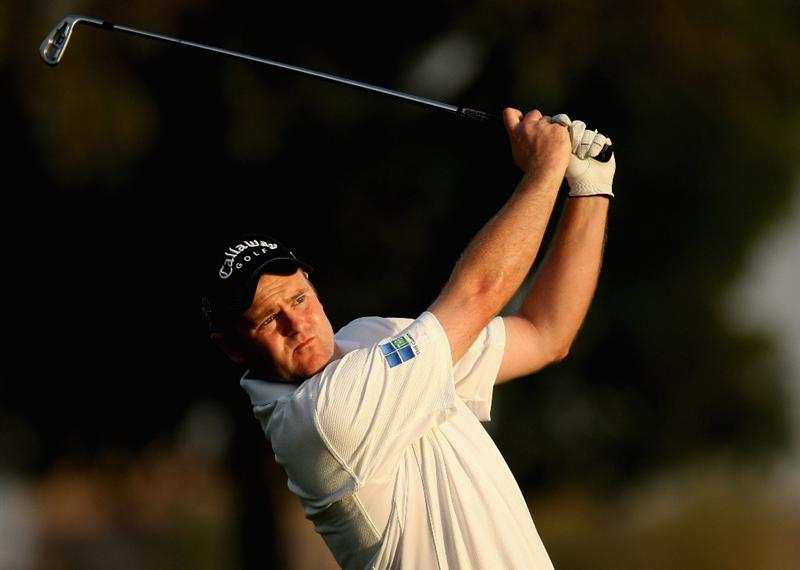 DUBAI, UNITED ARAB EMIRATES - JANUARY 29:  Alastair Forsyth of Scotland plays his second shot to the par five 18th hole during the first round of the Dubai Desert Classic on the Majlis Course on January 29, 2009 in Dubai,United Arab Emirates.  (Photo by Ross Kinnaird/Getty Images)