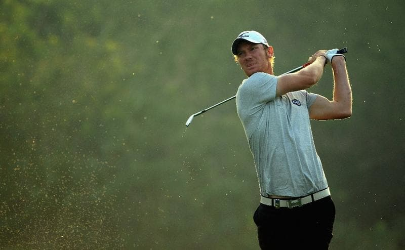 DUBAI, UNITED ARAB EMIRATES - FEBRUARY 10:  Chris Wood of England  in action during the first round of the Omega Dubai Desert Classic on the Majlis course at the Emirates Golf Club on February 10, 2011 in Dubai, United Arab Emirates.  (Photo by Andrew Redington/Getty Images)
