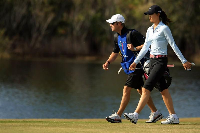 DAYTONA BEACH, FL - DECEMBER 06:  Michelle Wie walks with her caddie Tim Vickers on the 13th hole during the fourth round of the LPGA Qualifying School at LPGA International on December 6, 2008 in Daytona Beach, Florida.  (Photo by Scott Halleran/Getty Images)