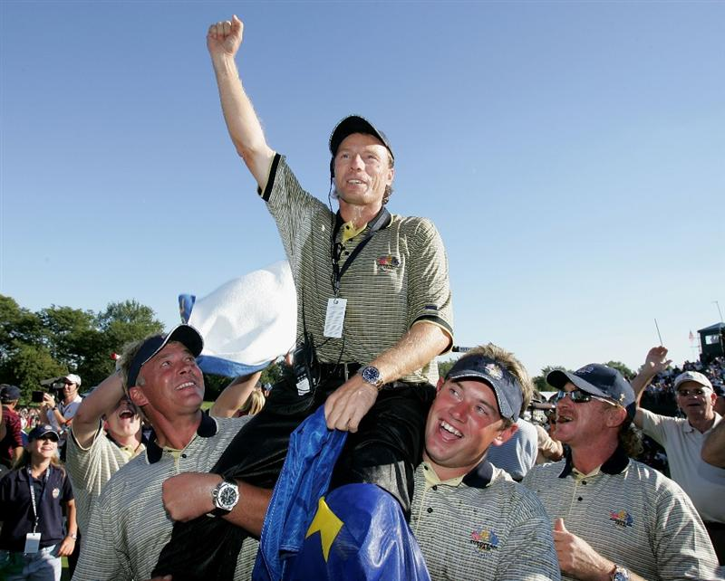 BLOOMFIELD TOWNSHIP, MI - SEPTEMBER 19:  European team captain Bernhard Langer celebrates with his teammates after Europe win the Ryder Cup Cup 18 1/2 to 9 1/2 at the 35th Ryder Cup Matches at the Oakland Hills Country Club on September, 19 2004 in Bloomfield Township, Michigan. (Photo by Andrew Redington/Getty Images)