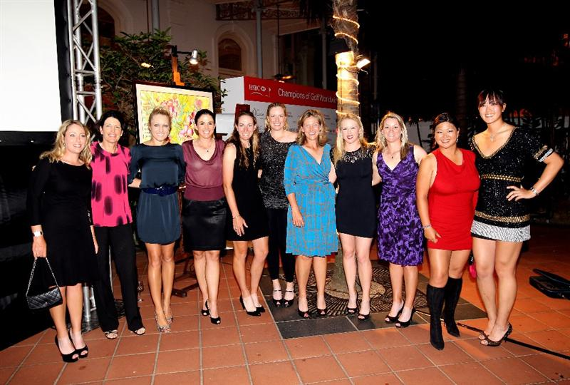 SINGAPORE - FEBRUARY 24:  (Left to right) Cristie Kerr, Juli Inkster, Natalie Gulbis, Nicole Castrale, Brittany Lang, Brittany Lincicome, Angela Stanford,  Morgan Pressel, Kristy McPherson, Christina Kim and Michelle Wie (all of the USA) pose for a photograph during the Welcome Reception prior to the start of the HSBC Women's Champions at the Tanah Merah Country Club  on February 24, 2010 in Singapore.  (Photo by Andrew Redington/Getty Images)