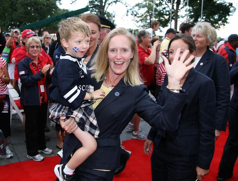SUGAR GROVE, IL - AUGUST 20:  Janice Moody of Scotland with her son during the Opening Ceremony for the 2009 Solheim Cup Matches, at the Rich Harvest Farms Golf Club on August 18, 2009 in Sugar Grove, Ilinois  (Photo by David Cannon/Getty Images)