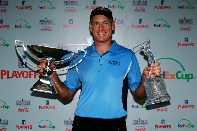 ATLANTA - SEPTEMBER 26:  Jim Furyk celebrates with THE TOUR Championship trophy (R) and the FedExCup Trophy (L) after winning THE TOUR Championship presented by Coca-Cola, the final event of the PGA TOUR Playoffs for the FedExCup, at East Lake Golf Club on September 26, 2010 in Atlanta, Georgia.  (Photo by Scott Halleran/Getty Images)