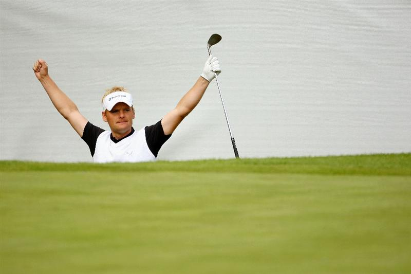 WENTWORTH, ENGLAND - MAY 22: Soren Kjeldsen of Denmark celebrates after chipping in for birdie on the 16th hole during the Second Round of the BMW PGA Championship at Wentworth on May 22, 2009 in Virginia Water, England.  (Photo by Richard Heathcote/Getty Images)