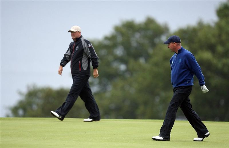 DUMBARTON, SCOTLAND - SEPTEMBER 19: James Lee of Wales (L) and Andrew Barnett of Wales and the Great Britain and Ireland Team walk onto the 10th green during the morning foursome matches at The Carrick on Loch Lomond on September 19, 2009 in Dumbarton, Scotland.  (Photo by David Cannon/Getty Images)
