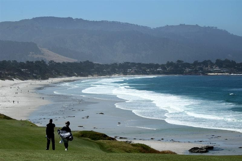 PEBBLE BEACH, CA - JUNE 16:  (L-R) Henrik Stenson of Sweden walks with his caddie Fanny Sunneson during a practice round prior to the start of the 110th U.S. Open at Pebble Beach Golf Links on June 16, 2010 in Pebble Beach, California.  (Photo by Andrew Redington/Getty Images)