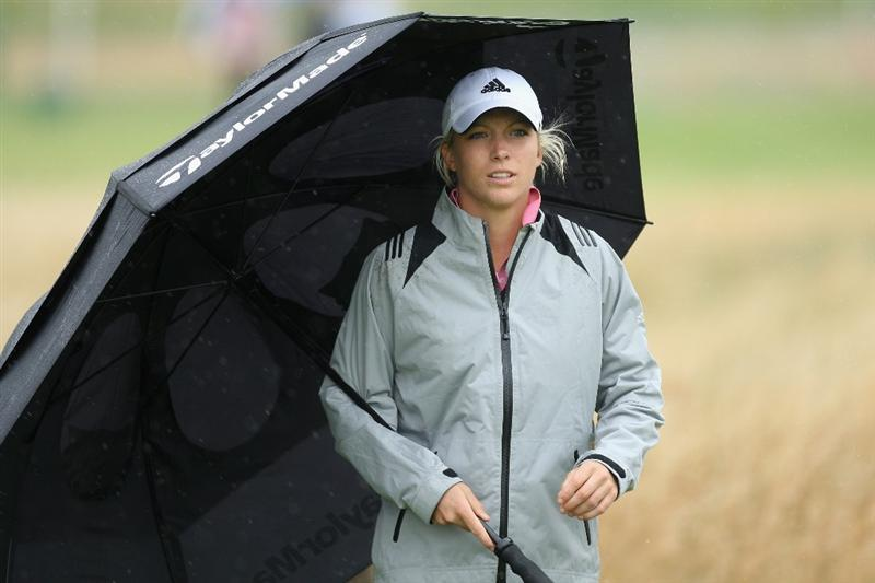 LYTHAM ST ANNES, ENGLAND - JULY 28:  Melissa Reid of England walks  with an umbrella during the Pro-Am prior to the 2009 Ricoh Women's British Open Championship held at Royal Lytham St Annes Golf Club, on July 28, 2009 in  Lytham St Annes, England.  (Photo by David Cannon/Getty Images)