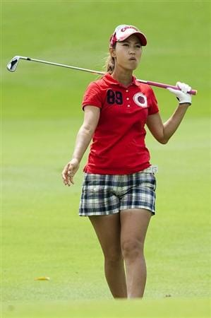 CHON BURI, THAILAND - FEBRUARY 17:  Momoko Ueda of Japan looks at her second shot on the 15th hole during day one of the LPGA Thailand at Siam Country Club on February 17, 2011 in Chon Buri, Thailand.  (Photo by Victor Fraile/Getty Images)