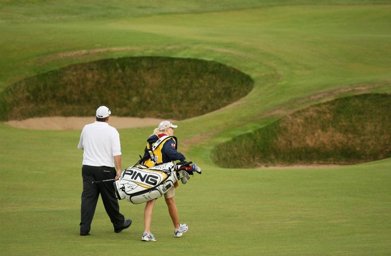 TURNBERRY, SCOTLAND - JULY 16:  Mark Calcavecchia of USA walks with his wife/caddy Brenda to the 5th green during round one of the 138th Open Championship on the Ailsa Course, Turnberry Golf Club on July 16, 2009 in Turnberry, Scotland.  (Photo by Ross Kinnaird/Getty Images)