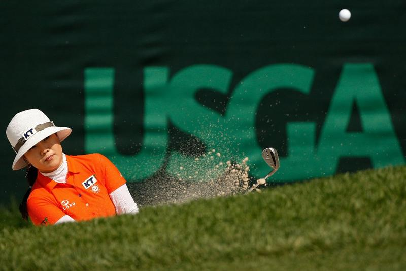 BETHLEHEM, PA - JULY 10:  Meena Lee of South Korea chips out of a bunker on the 18th hole during the second round of the 2009 U.S. Women's Open at Saucon Valley Country Club on July 10, 2009 in Bethlehem, Pennsylvania.  (Photo by Chris Graythen/Getty Images)