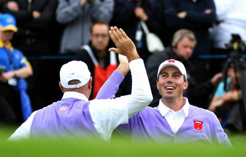 NEWPORT, WALES - OCTOBER 02:  Stewart Cink (L) of the USA celebrates his birdie putt on the 17th green with playing partner Matt Kuchar during the rescheduled Afternoon Foursome Matches during the 2010 Ryder Cup at the Celtic Manor Resort on October 2, 2010 in Newport, Wales.  (Photo by Jamie Squire/Getty Images)