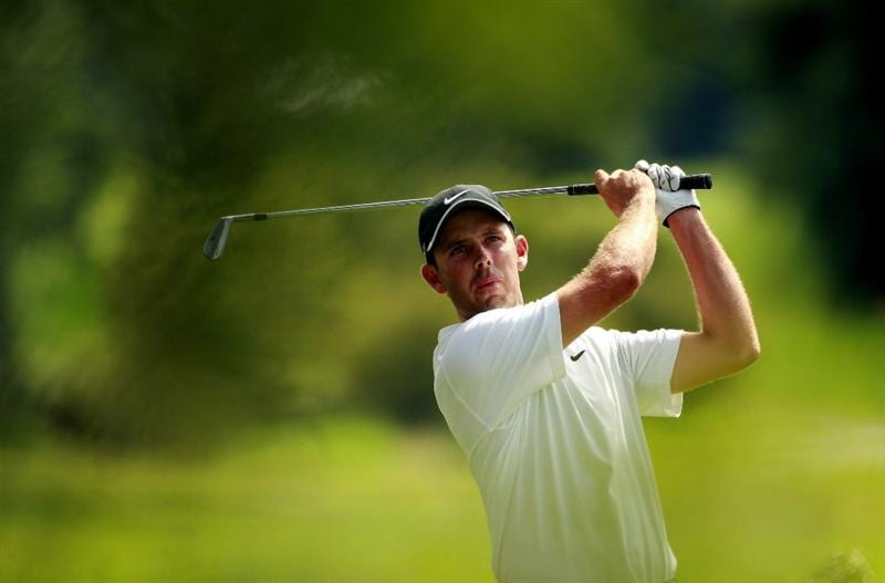 JOHANNESBURG, SOUTH AFRICA - JANUARY 16:  Charl Schwartzel of South Africa plays his second shot into the 15th green during the fourth round of the Joburg Open at Royal Johannesburg and Kensington Golf Club on January 16, 2011 in Johannesburg, South Africa.  (Photo by Warren Little/Getty Images)