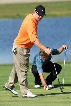 CHAMPIONS GATE, FLORIDA - DECEMBER 02: David Duval lines up a putt for his stepson Deano Karavites on the 5th green during the final round of the 2007 Del Webb Father Son Challenge on the International Course at Champions Gate Golf Club, on December 2, 2007 in Champions Gate, Florida,  (Photo by David Cannon/Getty Images)