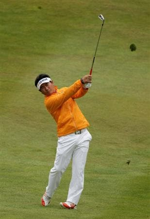 VIRGINIA WATER, ENGLAND - MAY 28:  Y.E. Yang of Korea hits an approach on the 7th hole during the third round of the BMW PGA Championship at the Wentworth Club on May 28, 2011 in Virginia Water, England.  (Photo by Ross Kinnaird/Getty Images)