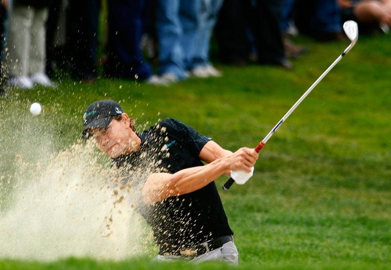 SAN FRANCISCO - OCTOBER 08:  Camilo Villegas of the International Team plays a bunker shot to the first green during the Day One Foursome Matches of The Presidents Cup at Harding Park Golf Course on October 8, 2009 in San Francisco, California.  (Photo by Scott Halleran/Getty Images)