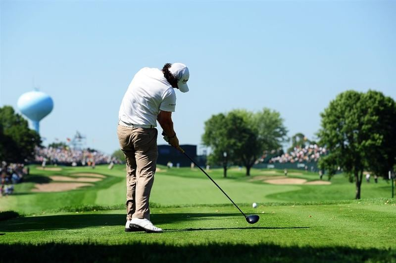 CHASKA, MN - AUGUST 14:  Rory McIlroy of Northern Ireland hits his tee shot on the ninth hole during the second round of the 91st PGA Championship at Hazeltine National Golf Club on August 14, 2009 in Chaska, Minnesota.  (Photo by Stuart Franklin/Getty Images)