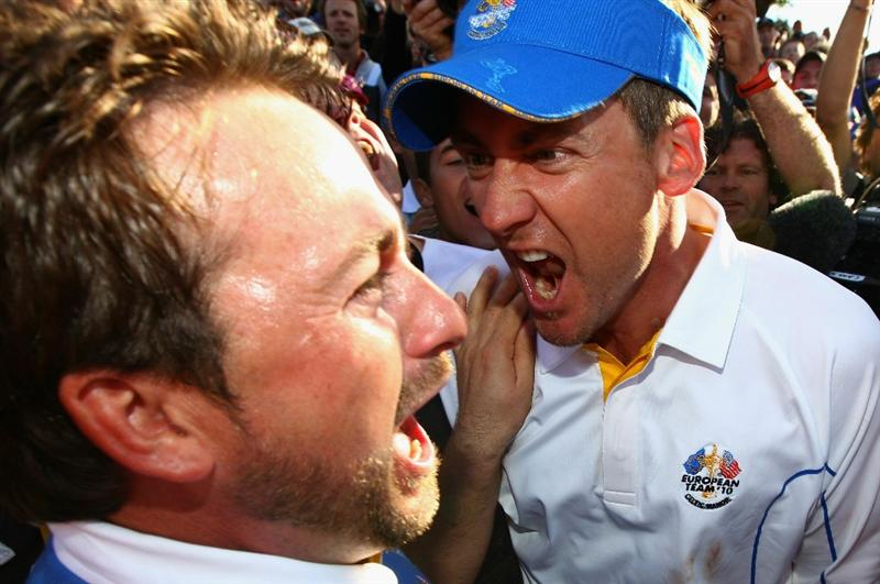 NEWPORT, WALES - OCTOBER 04:  Graeme McDowell of Europe celebrates his 3&1 win to secure victory for  the European team on the 17th green with Ian Poulter (R) in the singles matches during the 2010 Ryder Cup at the Celtic Manor Resort on October 4, 2010 in Newport, Wales.  (Photo by Richard Heathcote/Getty Images)