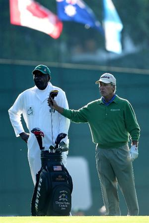 AUGUSTA, GA - APRIL 09:  Ben Crenshaw pulls a club as his caddie Carl Jackson looks on during the second round of the 2010 Masters Tournament at Augusta National Golf Club on April 9, 2010 in Augusta, Georgia.  (Photo by Andrew Redington/Getty Images)