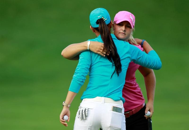 GLADSTONE, NJ - MAY 20: Michelle Wie (L) hugs a defeated Anna Nordqvist (R) of Sweden on the second playoff hole in round two of the Sybase Match Play Championship at Hamilton Farm Golf Club on May 20, 2011 in Gladstone, New Jersey. (Photo by Chris Trotman/Getty Images)