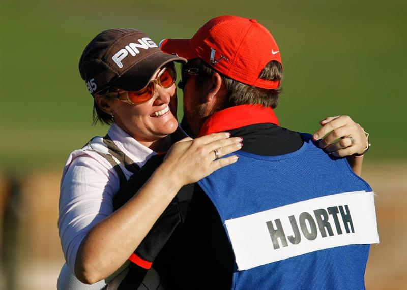 ORLANDO, FL - DECEMBER 05:  Maria Hjorth of Sweden celebrates with her caddie Mark Britton on the 18th green after winning the LPGA Tour Championship at the Grand Cypress Resort on December 5, 2010 in Orlando, Florida.  (Photo by Scott Halleran/Getty Images)