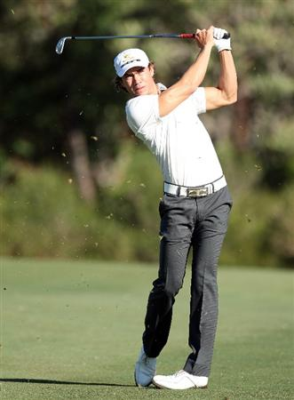 PERTH, AUSTRALIA - FEBRUARY 19:  Camilo Villegas of Colombia hits his second shot at the 14th hole during the first round of the 2009 Johnnie Walker Classic tournament at the Vines Resort and Country Club, on 19 February 2009, in Perth, Australia  (Photo by David Cannon/Getty Images)