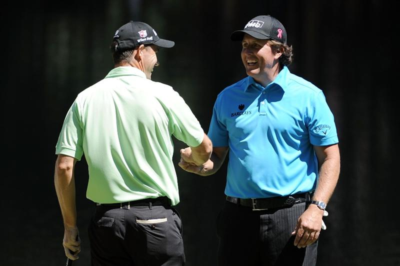 AUGUSTA, GA - APRIL 06:  Padraig Harrington of Ireland shakes hands with Phil Mickelson during the Par 3 Contest prior to the 2011 Masters Tournament at Augusta National Golf Club on April 6, 2011 in Augusta, Georgia.  (Photo by Harry How/Getty Images)