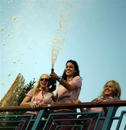 KILDARE, IRELAND - SEPTEMBER 24:  (L-R) Paul Casey's girlfriend Jocelyn Hefner, Luke Donald's fiancee Diane Antonopoulos and Morgan Norman celebrate on the clubhouse balcony with champagne after Europe win the Ryder Cup by a score of 18 ? - 9 ? on the final day of the 2006 Ryder Cup at The K Club on September 24, 2006 in Straffan, Co. Kildare, Ireland.  (Photo by Donald Miralle/Getty Images)