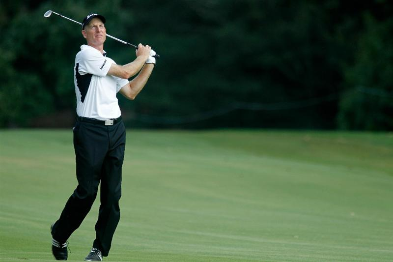 ATLANTA - SEPTEMBER 23:  Jim Furyk hits his approach shot on the 14th hole during the first round of THE TOUR Championship presented by Coca-Cola at East Lake Golf Club on September 23, 2010 in Atlanta, Georgia.  (Photo by Scott Halleran/Getty Images)