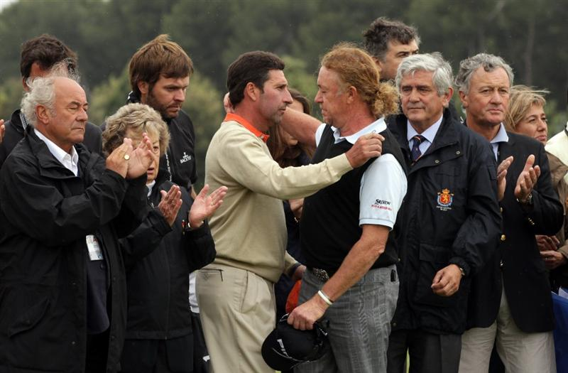 BARCELONA, SPAIN - MAY 07:  Jose Maria Olazabal of Spain and Miguel Angel Jimenez of Spain after the minute silence held in memory of Seve Ballesteros during the third round of the Open de Espana at the the Real Club de Golf El Prat on May 7 , 2011 in Barcelona, Spain.  (Photo by Ross Kinnaird/Getty Images)