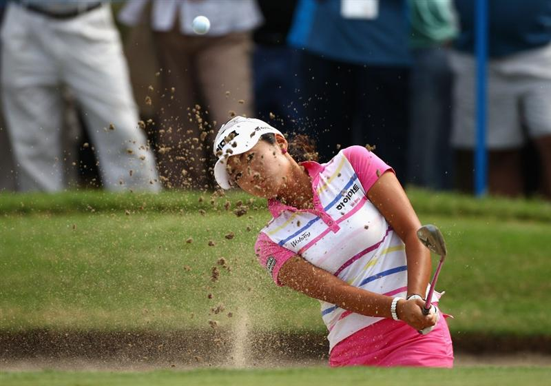 GOLD COAST, AUSTRALIA - MARCH 07:  Bo-Mee Lee of Korea plays a bunker shot on the 14th hole during round four of the 2010 ANZ Ladies Masters at Royal Pines Resort on March 7, 2010 in Gold Coast, Australia.  (Photo by Ryan Pierse/Getty Images)