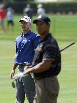 ORLANDO, FL - MARCH 15:  Ben Crane of the USA watches his second shot at the 10th hole as playing partner Tiger Woods of the USA prepares to play his shot during the third round of the 2008 Arnold Palmer Invitational presented by MasterCard at the Bay Hill Golf Club and Lodge, on March 15, 2008 in Orlando, Florida.  (Photo by David Cannon/Getty Images)