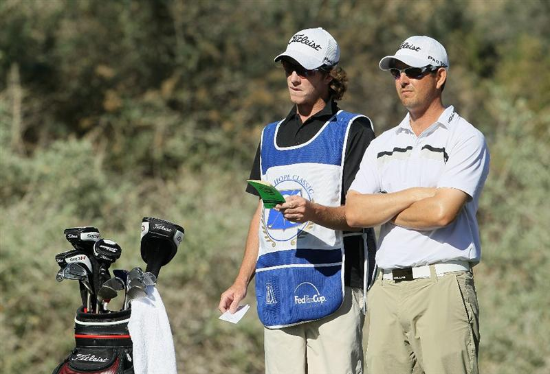 LA QUINTA, CA - JANUARY 20:  Matt McQuillan (R) of Canada and his caddie discuss a tee shot on the fifth hole during the second round of the Bob Hope Classic at the Nicklaus Private course at PGA West on January 20, 2011 in La Quinta, California.  (Photo by Jeff Gross/Getty Images)