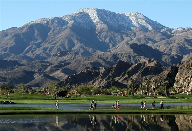 LA QUITNA, CA - JANUARY 23: A group walks from the tee on the 10th hole beneath a snow capped mountain on the Palmer Private course at PGA West during the third round of the Bob Hope Classic on January 23, 2010 in La Quinta, California. (Photo by Stephen Dunn/Getty Images)