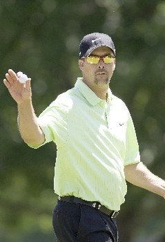 Chris Couch waves to the crowd after making birdie on hole #10 to go to -11 during the fourth round of the Rheem Classic at Hardscrabble Country Club in Fort Smith, AR, May 15, 2005.Photo by Wesley Hitt/WireImage.com