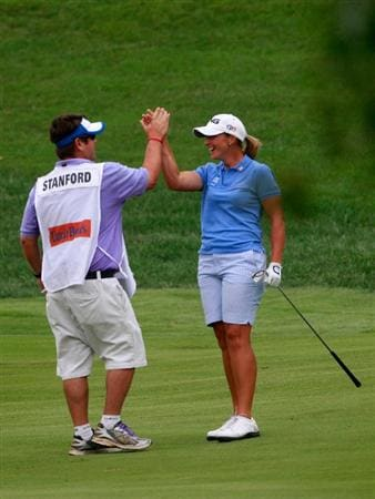 ROGERS, AR - SEPTEMBER 13:  Angela Stanford (R) is congratulated by her caddie Dave Chapman after she made an eagle on the par-5 second hole during final round play in the P&G Beauty NW Arkansas Championship at the Pinnacle Country Club on September 13, 2009 in Rogers, Arkansas.  (Photo by Dave Martin/Getty Images)