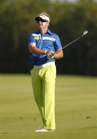 PLAYA DEL CARMEN, MEXICO - FEBRUARY 26:  Brian Gay hits his  second shot on the 16th hole during the third round of the Mayakoba Golf Classic at Riviera Maya-Cancun held at El Camaleon Golf Club on February 26, 2011 in Playa del Carmen, Mexico.  (Photo by Michael Cohen/Getty Images)
