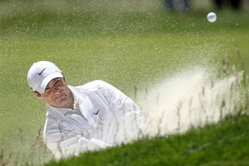 PEBBLE BEACH, CA - JUNE 17:  Trevor Immelman of South Africa hits a bunker shot on the 12th hole during the first round of the 110th U.S. Open at Pebble Beach Golf Links on June 17, 2010 in Pebble Beach, California.  (Photo by Ross Kinnaird/Getty Images)