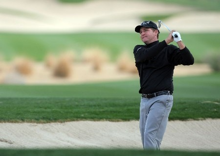 LA QUINTA, CA - JANUARY 16:  Jason Bohn watches his shot from the bunker on the 16th hole during the first round of the 49th Bob Hope Chrysler Classic at the Silverrock Resort on January 16, 2008 in La Quinta, California.  (Photo by Harry How/Getty Images)